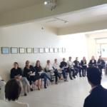 profissionais da saúde em uma sala para falar sobre Plano de Crise Covid da Eficiência Hospitalista e Promed